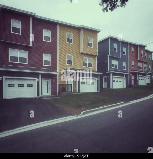New construction styled in St. John's Newfoundland's 'jelly bean' style. - Stock Image
