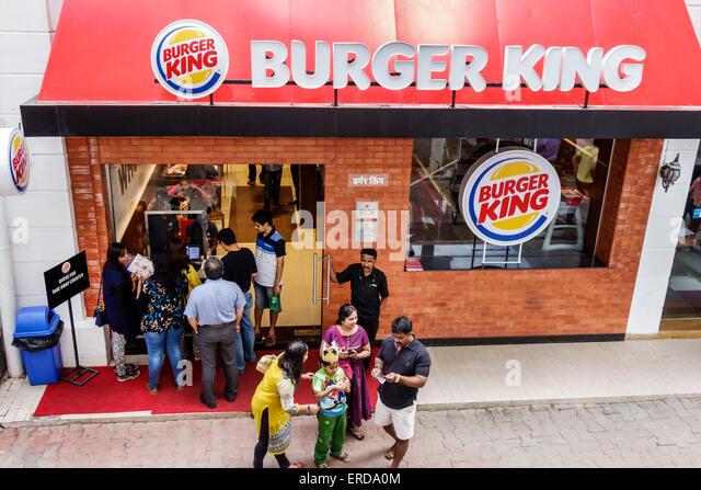 Mumbai India Asian Lower Parel High Street Phoenix mall inside shopping Burger King fast food restaurant front entrance - Stock Image