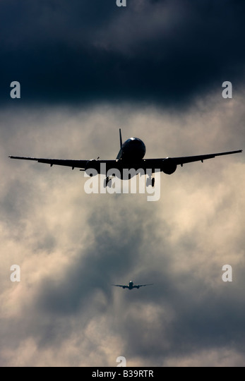 Commercial airplanes queuing up to land at London Heathrow Airport UK - Stock Image