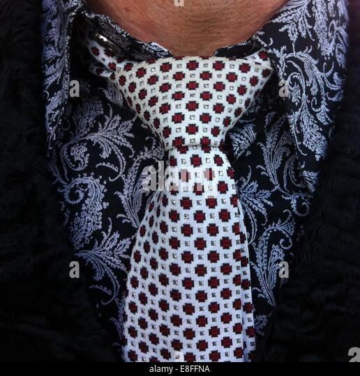 Close up of a man wearing a shirt and tie - Stock Image