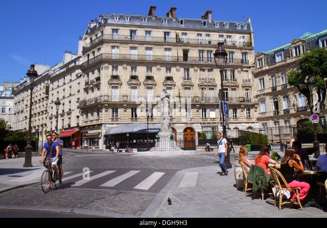 Paris France Europe French 9th arrondissement Place Saint St. Georges Haussmann apartment buildings monument restaurant - Stock Image