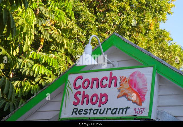 Florida Key West Florida Keys Bahamas Village Petronia Street sign Conch Shop restaurant shell - Stock Image