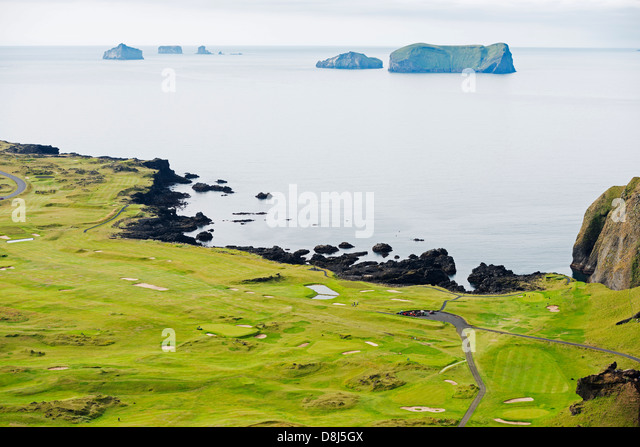 Iceland, Vestmannaeyjar, volcanic Westman Islands, Heimaey Island, golf course in volcanic crater - Stock Image
