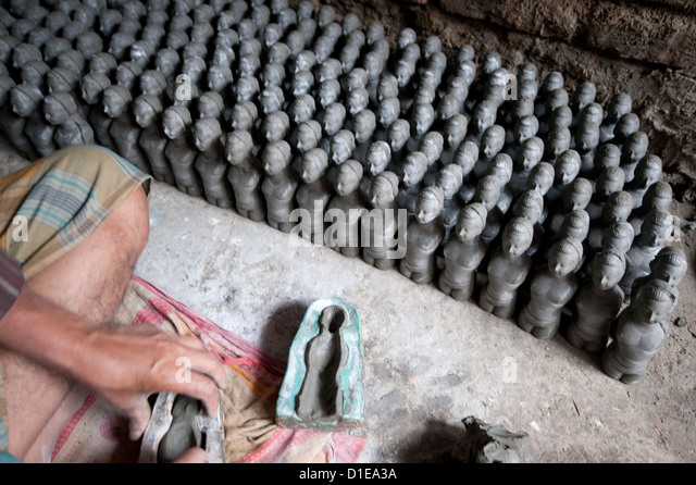 Models being made from clay from the River Hugli in moulds, Kumartuli district, Kolkata, West Bengal, India - Stock Image