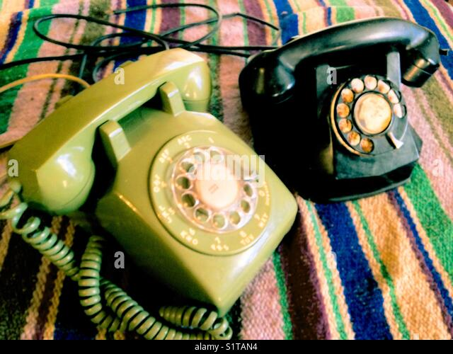2 eras of vintage telephones - Stock Image