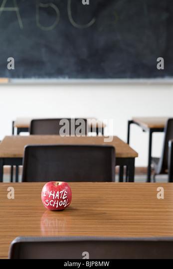 Apple on a desk - Stock Image