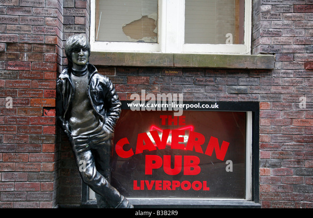 July 2008 - John Lennon statue by the Cavern Wall of Fame in Mathew Street Liverpool England UK - Stock Image
