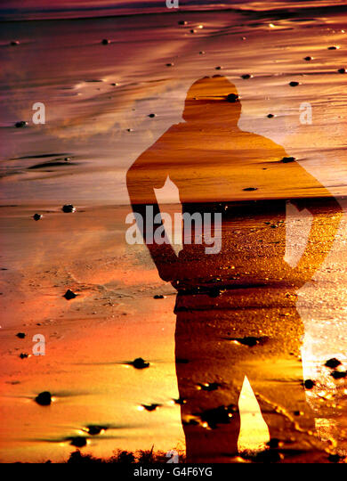 Sunset Shadow on Beach - Stock Image