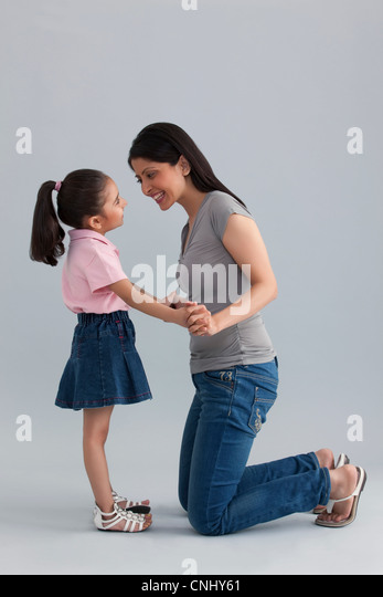 Mother and daughter having fun - Stock Image