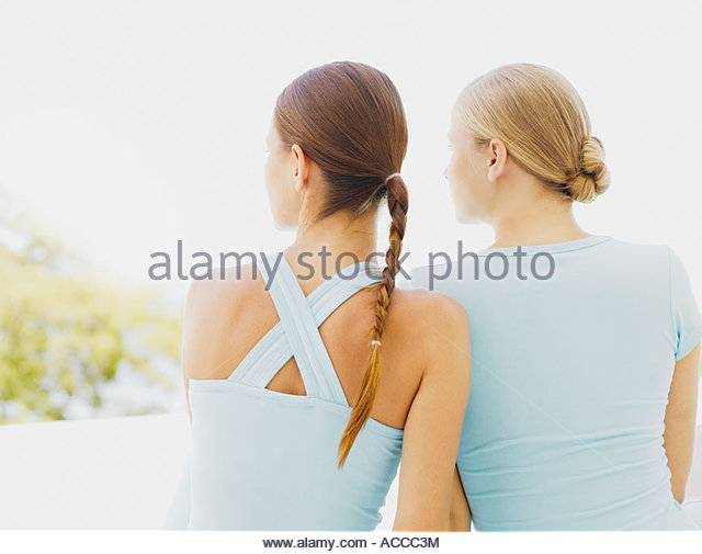 Rear view of two women outdoors - Stock Image