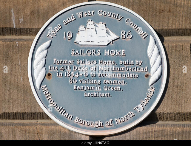 Blue plaque on the wall of the former Sailors' Home, now Old Custom House flats, North Shields, England, UK - Stock Image