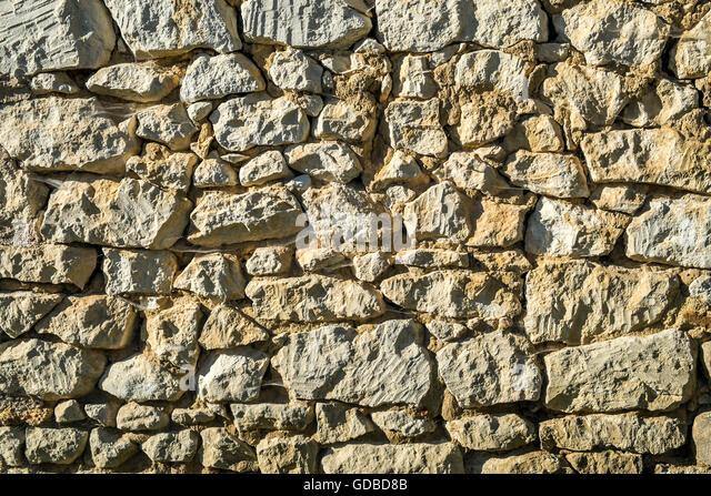 Rough random stone wall texture - France. - Stock Image