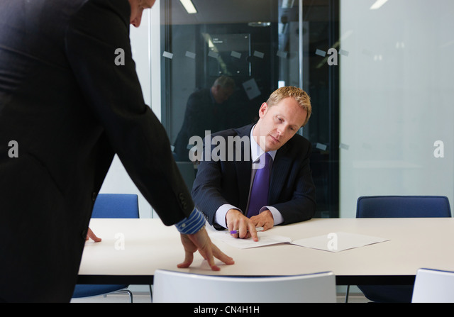 Manager in office with businessman - Stock Image