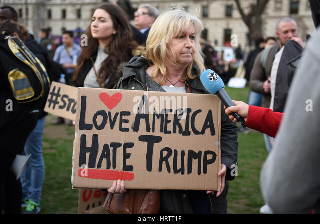 Placard: 'Love America Hate Trump' - Stop Trump & Stop Brexit demonstration in Parliament Square, London. - Stock Image