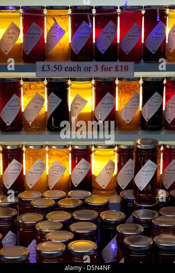 Jars of jam on stall at Real Food Market, Southbank, London - Stock Image