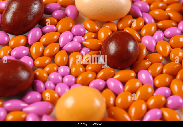 Colorful pattern made from dragee candies Abstract background - Stock Image