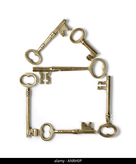 Home symbol made from shiny brass skeleton keys - Stock-Bilder