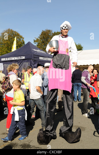 Man on stilts dressed as a chef at Narberth Food Festival Pembrokeshire Wales Cymru UK GB - Stock Image