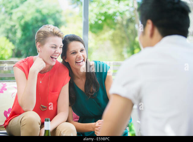 Women laughing at party - Stock-Bilder