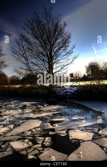 Ice on the Bridgewater canal winter in Grappenhall Warrington Cheshire, UK - Stock Image