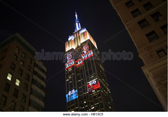 The Empire State building displays a 2016 U.S. Presidential election themed light show in New York, U.S. November - Stock-Bilder