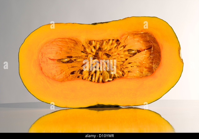 Detail of a squash (gourd family) cut in half - Stock Image