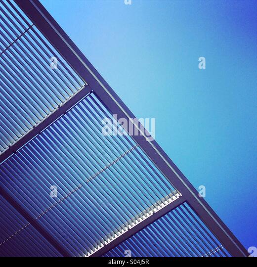 Steal grate with blue sky, abstract - Stock Image