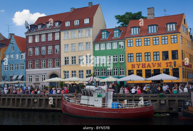 Colorful houses in the Nyhavn area of Copenhagen, Denmark - Stock Image