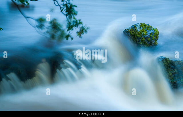 Water flowing down a small stream - Stock-Bilder