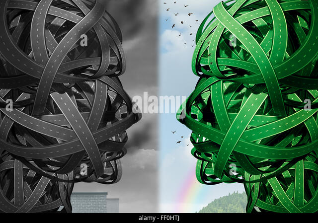 Transportation ecological choice as a group of tangled roads shaped as a human head facing another green group of - Stock Image