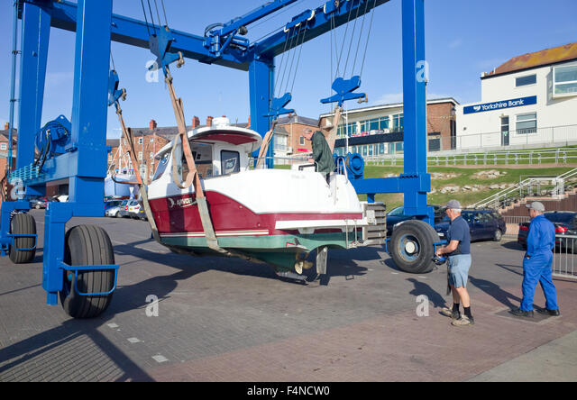 Launching boat stock photos launching boat stock images for Boat lift motors near me