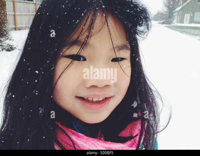 Young girl with snow in hair - Stock Image