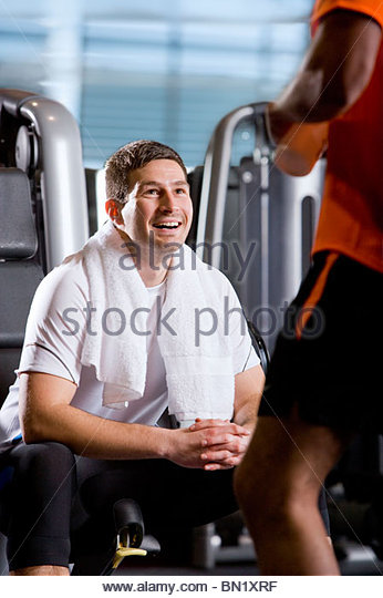 Men talking in health club - Stock Image