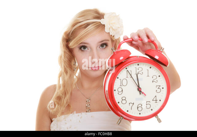 Wedding. Time to get married. Bride with alarm clock. - Stock Image