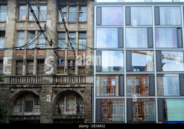 contrasting old and new renovated buildings in Mitte Berlin Germany - Stock Image