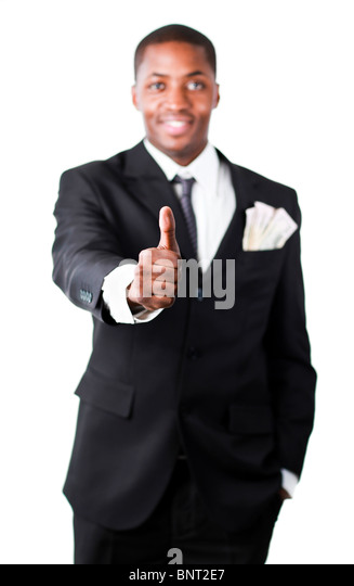 Happy businessman with dollars in a pocket showing thumb up - Stock Image