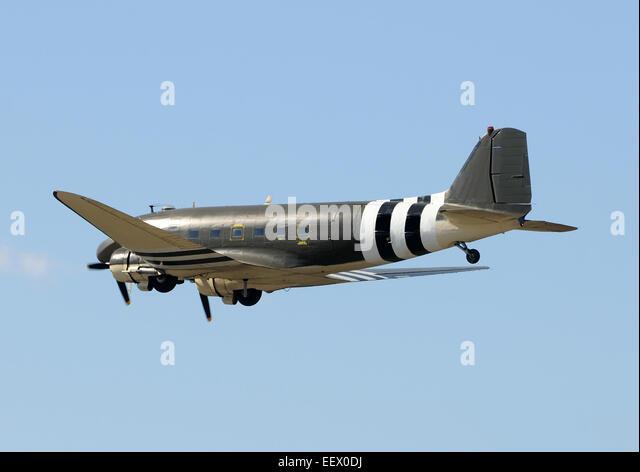Retro propeller airplane in leveled flight DC-3 - Stock Image
