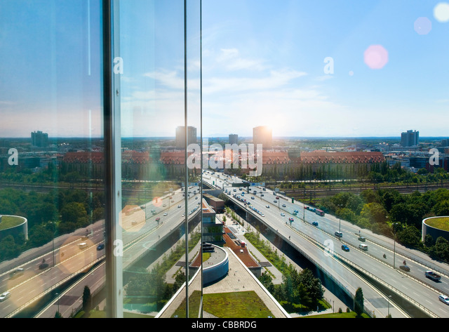 Glass building overlooking city center - Stock Image