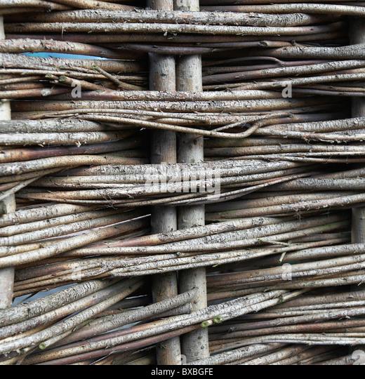 Woven hazel fencing - Stock Image
