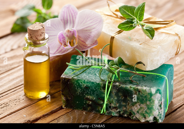 Pieces of natural soap with herbs and oil. - Stock Image