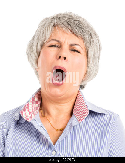 Portrait of a elderly woman with a sleepiness expression - Stock Image