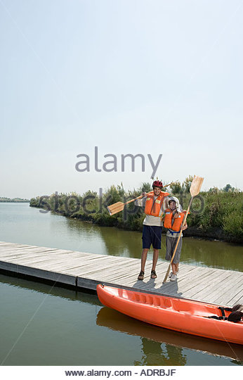 Father and son going canoeing - Stock Image