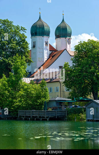 Benedictine monastery Seeon with monastery church of St. Lambert, Klostersee, Seebruck, Chiemgau, Upper Bavaria, - Stock Image