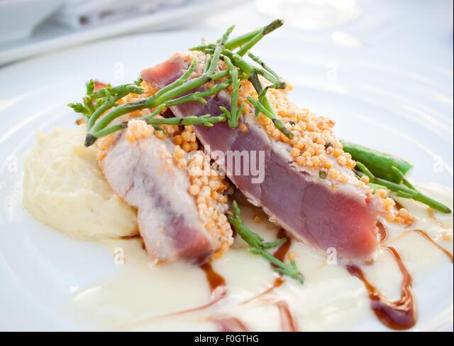 Seared Bigeye tuna (ahi tuna) steak with sea asparagus and wasabi mashed potatoes. Brown's Beach House, Fairmont - Stock Image
