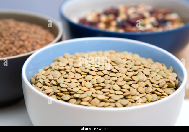 Dried green lentils - Stock Image