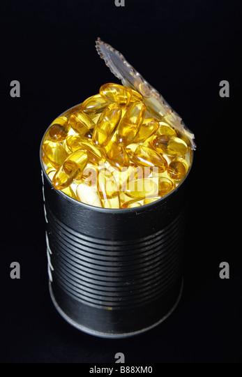 Fish Oil Capsules in a Tuna Fish Can - Stock Image