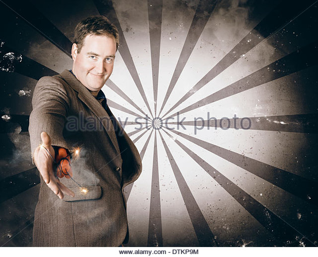 Deceitful businessman offering out a dishonest dynamite handshake with deadly consequences when handing out a dodgy - Stock Image