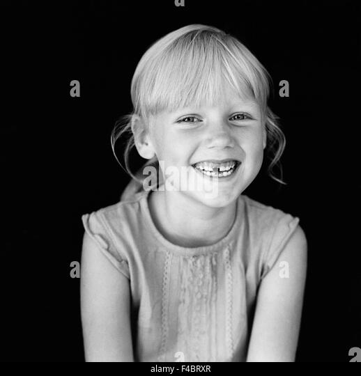 black and white blonde children only girls happy indoors one person only optimism portrait positive smiling tooth - Stock-Bilder