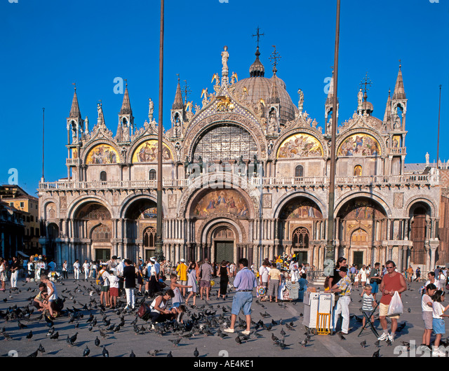 Italy venice St Marks square San Marco tourists with pigeons - Stock Image