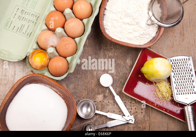 sponge cake ingredients eggs sugar flour lemon baking powder - Stock Image